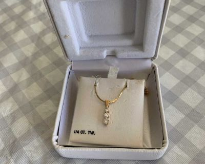 Diamond necklace on gold chain.