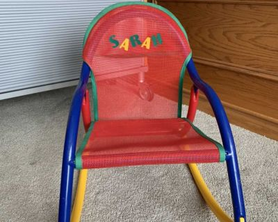 Rocking chair folds flat for travel