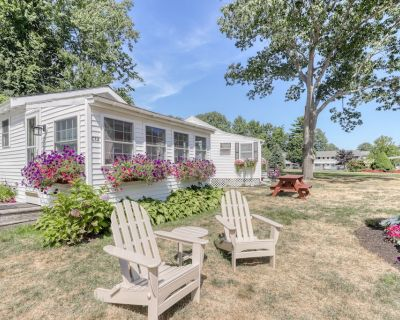 Cottage w/chairs to relax in front and shared sun deck and pool - Wells