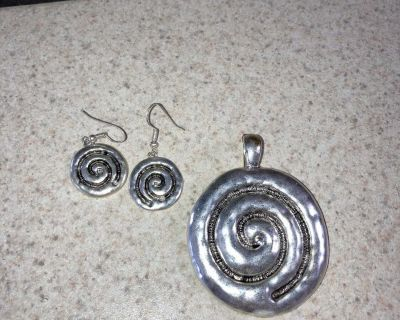 Gently used pendant and earrings. Not real silver