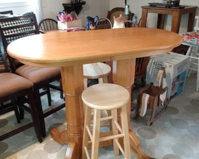 Oval solid wood bistro table with two solid wood stools
