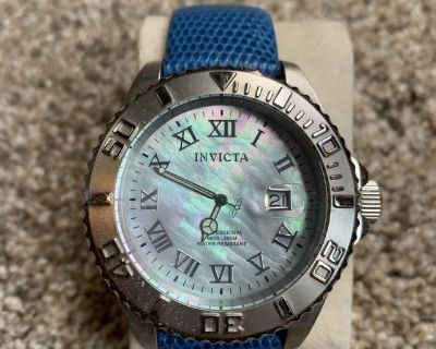 Invicta dive watch with mother of pearl dial