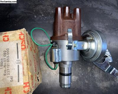Restored 211905205Q distributor with NOS vac can