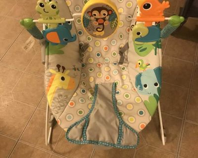 Bouncy seat missing piece holds battery works great