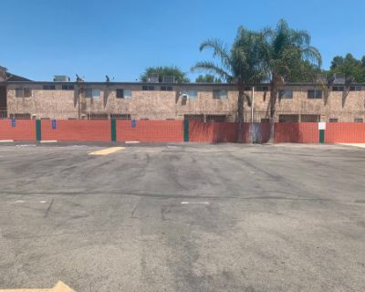Parking Lot next to Brick Buildings, Los Angeles, CA