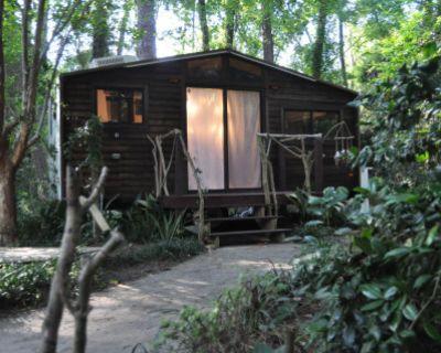 Tiny House Cabin Glamper in Camelia Garden with Rustic Barn Shed, Valdosta, GA