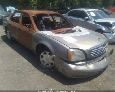 Salvage Gold 2002 Cadillac Deville