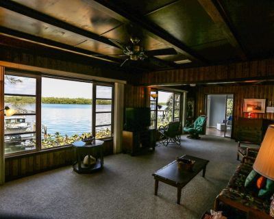 Welcome to 4851 Dolphin Lane. Location and bay views are the focal point of this amazing two-story waterfront duplex property. - Mid Island