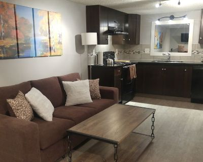 Canadian Inspired, Home Suite Home, 2bed, 1.5bath, full kitchen and fireplace - Northwest Calgary