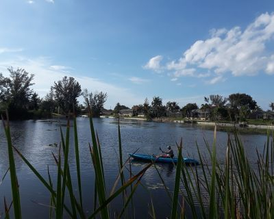 Great vacation rental on a Lake front home with access to canals. - Pelican