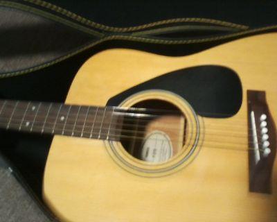 Yamaha f310 acustic guitar with hard case. 150.00 obo