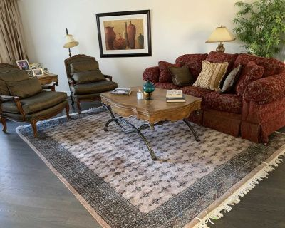 Luxurious Couch, coffee table and accent chairs
