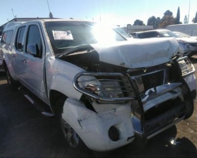 Salvage White 2013 Nissan Frontier