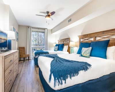 Studio condo with two full beds & tram - Baytowne Wharf
