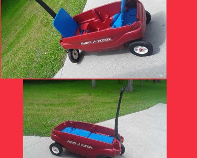 2 child radio flyer wagon with seatbelts . Seats fold down for flat surface and storage underneath