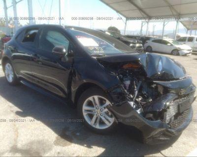 Salvage Blue 2021 Toyota Corolla Hatchback