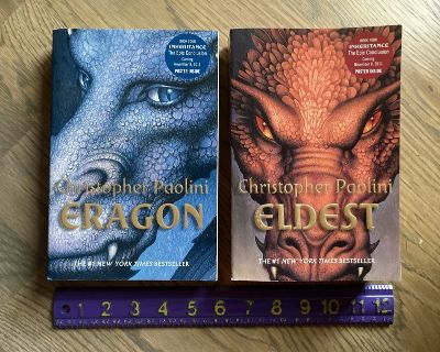 Like new! 2 Softcover Trade Books by Christopher Paolini- Eragon + Eldest