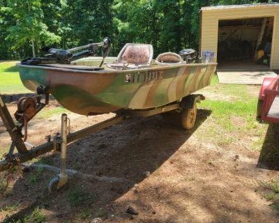 FS/FT Jon boat with 7.5 hp motor