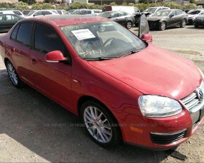 Salvage Red 2009 Volkswagen Jetta Sedan