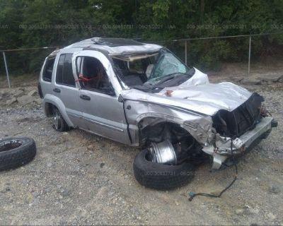 Salvage Silver 2006 Jeep Liberty