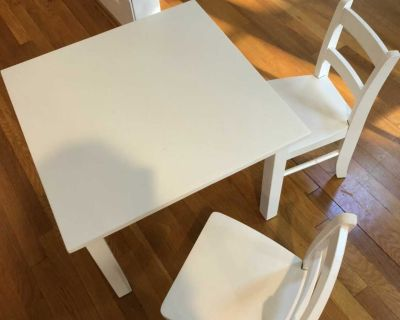 Pottery barn kids table with two chairs
