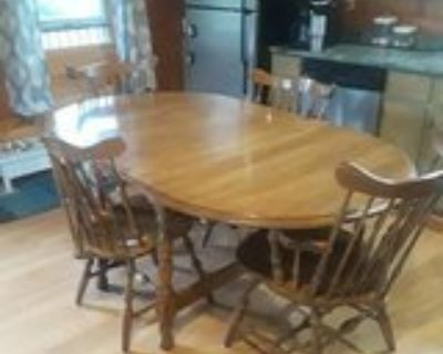 dinning room table with six chairs and 1 leaf