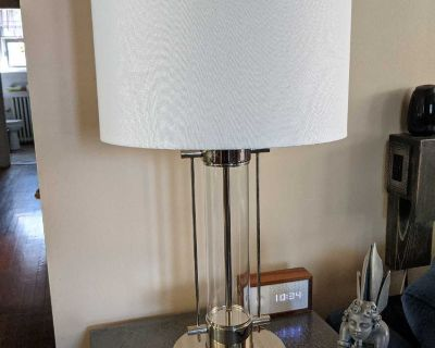 A gorgeous set of 2 chrome table lamps with off white shades