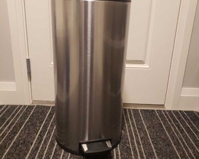 Tall metal garbage with foot pedal- great condition.