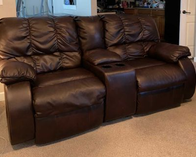 2 reclining couches and a TV console