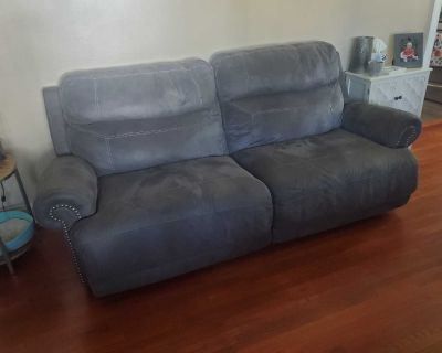 Reclining wall hugger couch
