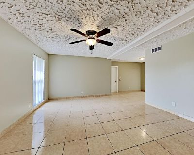Enjoy lovely living and dining areas with sleek tile flooring!