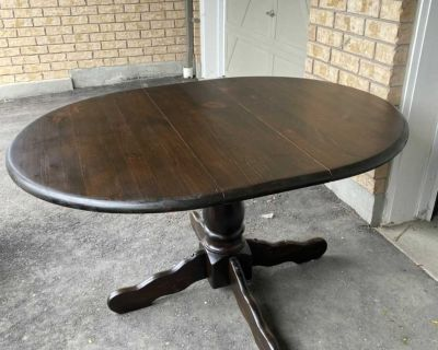 Recently refinished, solid wood table with leaf