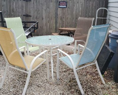 White Outdoor Patio Table and (4) Chairs - in good used condition