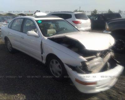 Salvage White 1996 Toyota Avalon