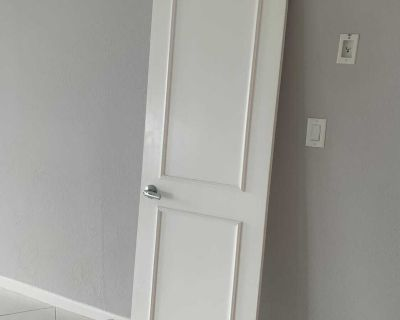 Wood doors with accent molding and hardware.