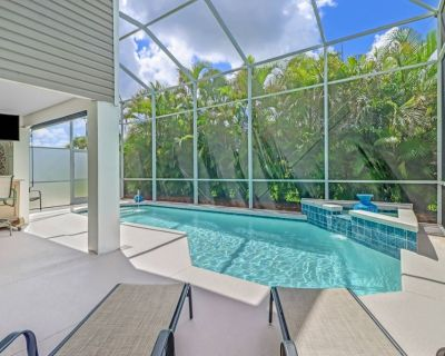 Wow - Outdoor Living Space! Canal, Heated Pool & Bikes! 2 Complete Guest Units - Great for Families! - Bonita Springs