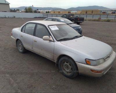 Salvage Gold 1997 Toyota Corolla