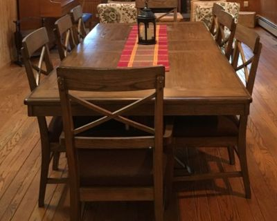 Extendable solid wood dining table with 8 chairs