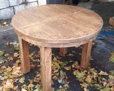 Round condo sized, expandable, dining table made from reclaimed lumber