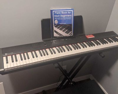 Keyboard with stand, book, and bench