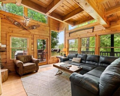 This cabin is a 2 bedroom(s), 2 bathrooms, located in Sevierville, TN. - Pigeon Forge