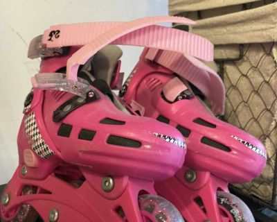 Multi-sized pink roller blades