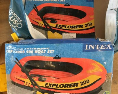 2 inflatable boats with paddles