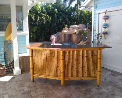 Bamboo Tiki Bar with storage cabinets. Outdoor patio furniture. Dining table
