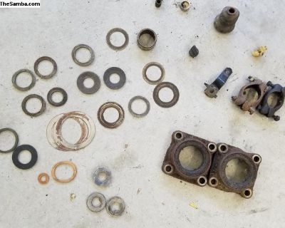 Misc shims, exhaust clamps. Axle bearing retainers