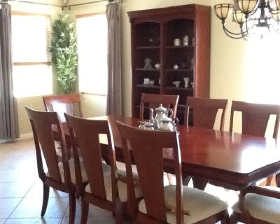 Cherry wood DR table with 8 chairs and matching hutch