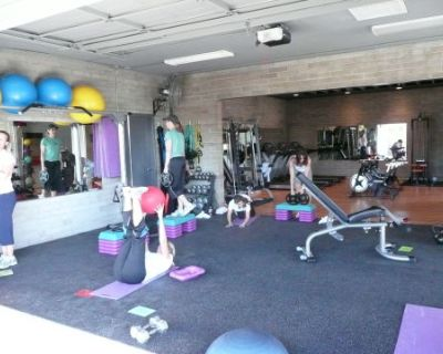 Fitness facility with a cool vibe built in an old mechanics garage with 2 huge garage doors., PHOENIX, AZ