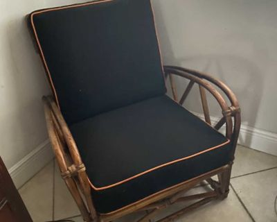 Heywood Wakefield wicker chair. Perfect for indoor/outdoor seating area with piped cushions. Excellent condition.