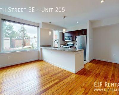 Hill East Sleek 2 Bedroom 1 Bathroom W/Modern Kitchen, Extra Storage Unit, Hardwood Flooring & Lovely Community Grounds