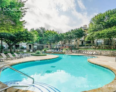 Tile and wood floors with private balconies.apartments in Summit Park At Wells Branch ..